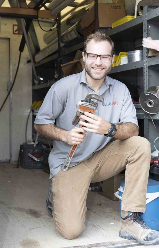 Just Right HVAC tech with tools