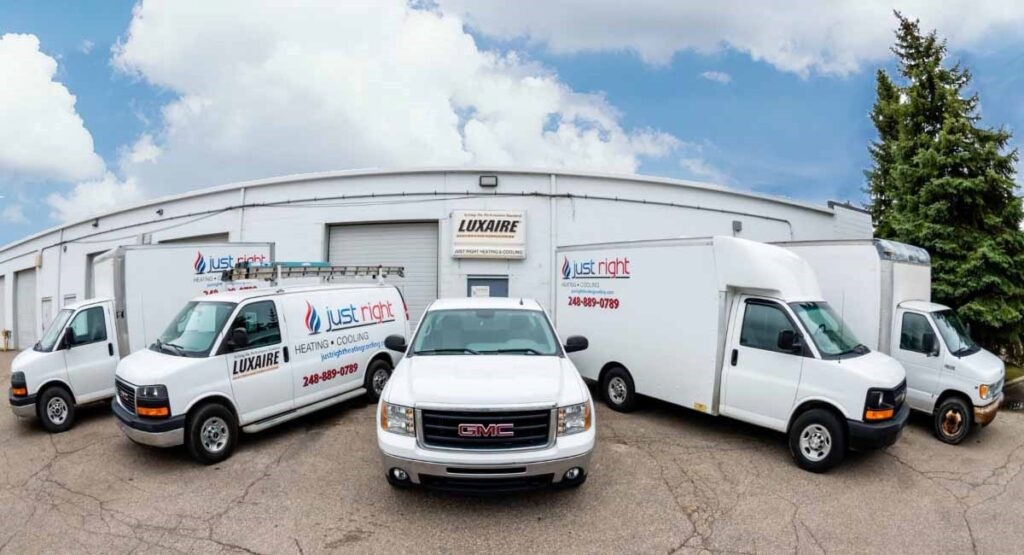 Fleet of HVAC Just Right Heating & Cooling vehicles in Waterford Township