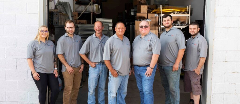Just Right Heating & Cooling team in front of Waterford Township HVAC shop